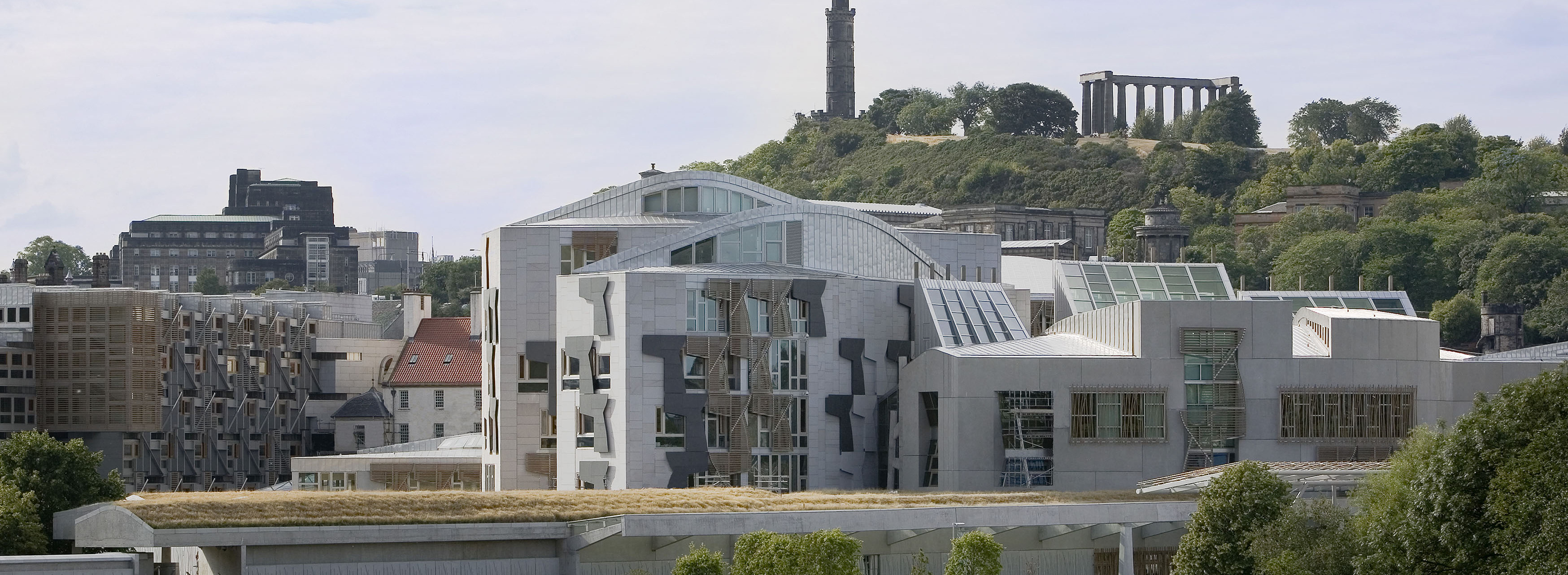 16 august 2006Scottish Parliament photographed from Salisbury Crags with the Nelson Monument on Calton Hill behind.  For BBC @ the TUN Pic-Andrew Cowan/Scottish Parliament