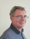 The image shows a portrait photograph of David Eade, treasurer to the board of Shared Care Scotland