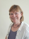 The image shows a photograph of Moira Oliphant, director on Shared Care Scotland's board