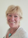 The image shows a portrait photograph of Rhona Graham, director on Shared Care Scotland's board