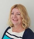 The image shows a portrait photograph of Alison Brown, Short Breaks Fund manager at Shared Care Scotland