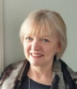 The image shows a portrait picture of Julie Crawford, administrator at Shared Care Scotland